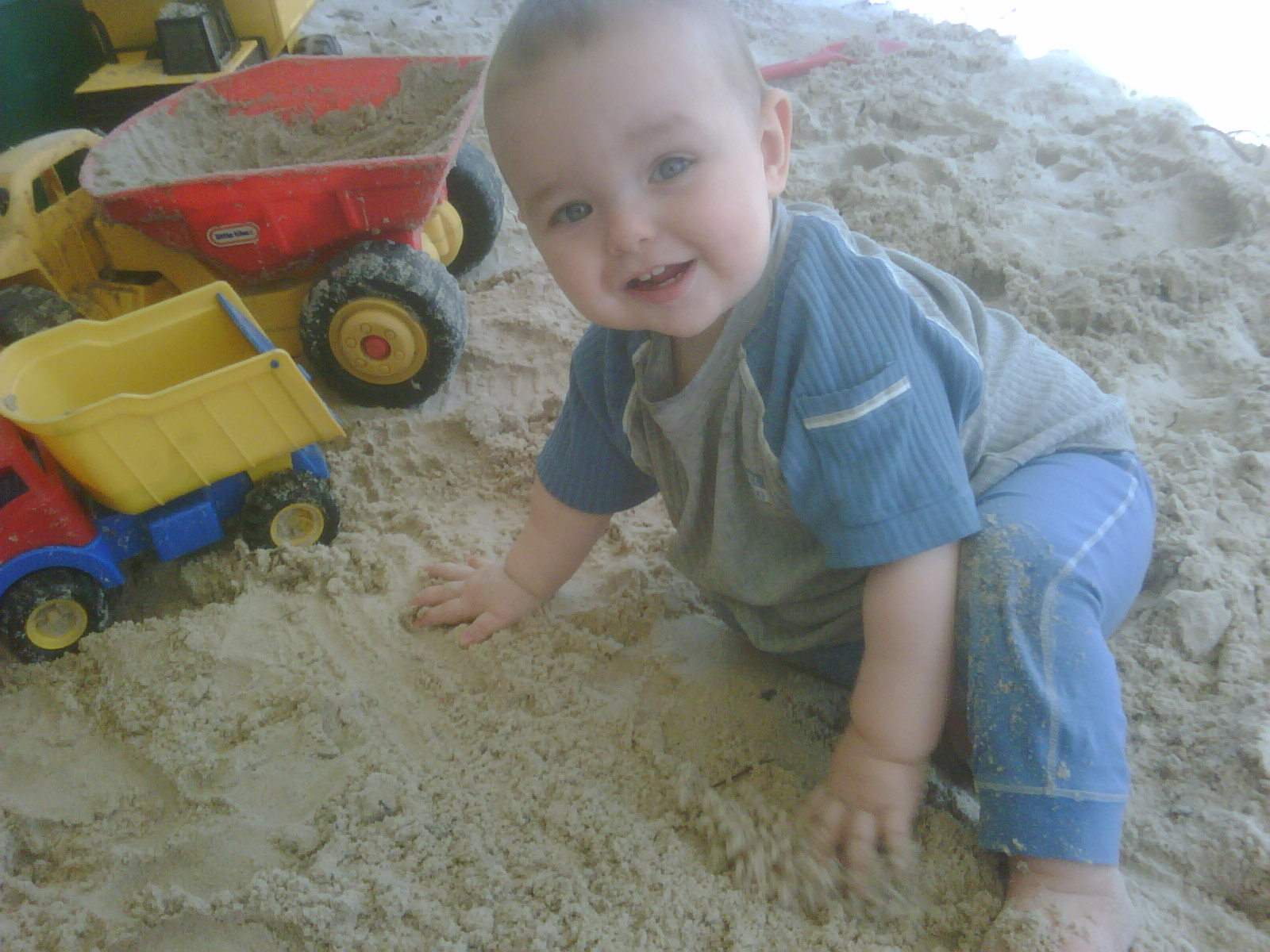 Master 6 ate fists full of sand before he was 1 year old!  Yum!